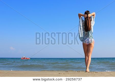 girl on the beach enjoying the ocean view