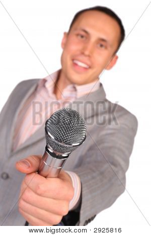 Man Holds Microphone In Hand