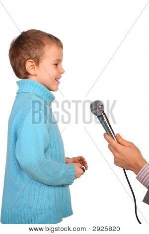 Boy Speaks Into Microphone