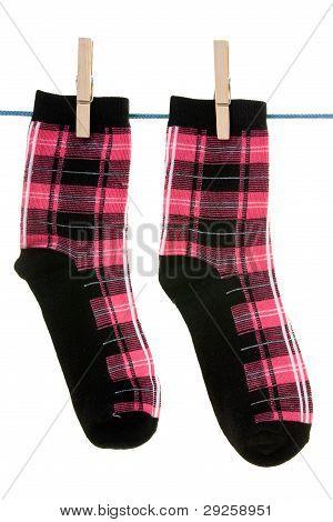 Two Socks Hang On Rope