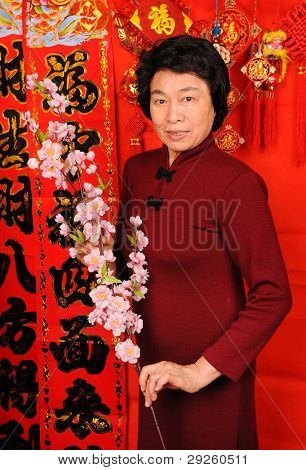 Chinese woman holding flower means happy new year