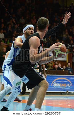 KAPOSVAR, HUNGARY - JANUARY 21: Michael Fey (white) in action at a Hungarian National Championship basketball game with Kaposvar (white) vs. Szolnok (black) on January 21, 2012 in Kaposvar, Hungary.