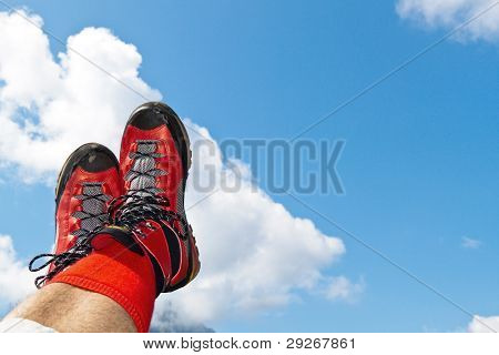 red hiking boots on a hike in the mountains of austria. activity during leisure time