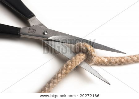 Scissors cuts a rope