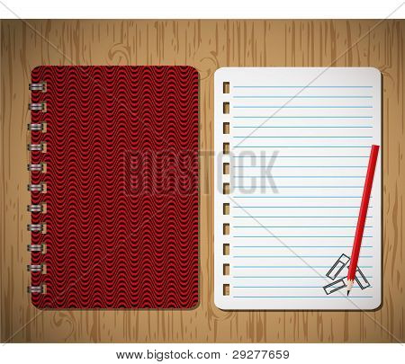 Red cover wave and paper sheet with pencil on wooden background.