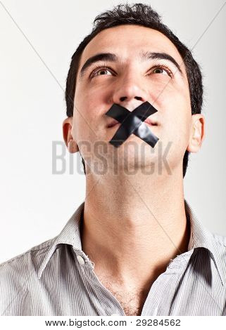 Silenced man with tape on his mouth - isolated over a white background