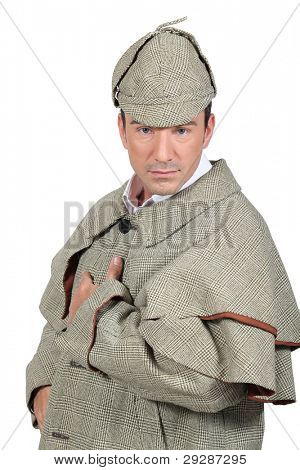 Man dressed like Sherlock Holmes and looking at us.
