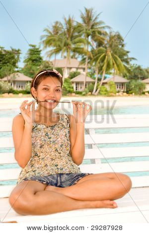 cheerful girl on a bench