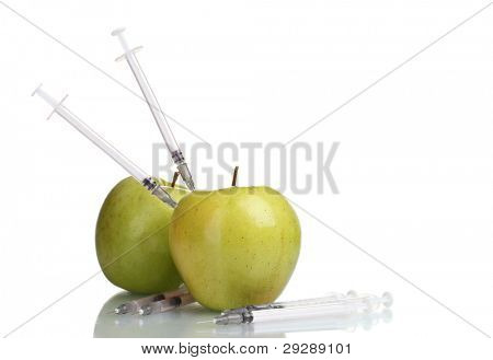 green apples and syringes isolated on white