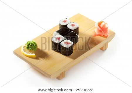 Maguro Maki Sushi - Roll with Fresh Tuna on the Wood Plate