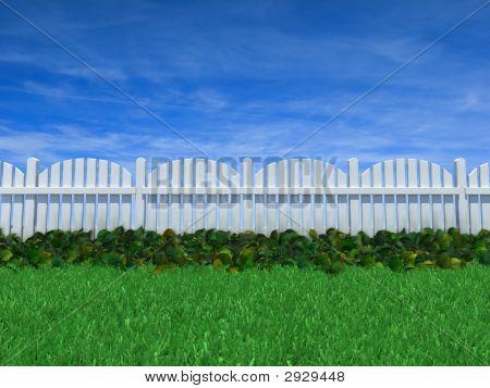 Fence On A Grass Field Under Blue Sky