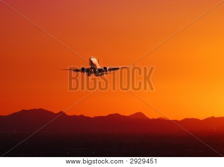 Plane Taking Off At Sunset, Arizona