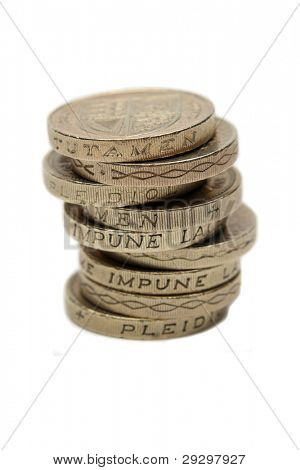 A Pile Of One Pound British Coins Stacked Showing The Royal Standard The Reverse Side Of The Coin
