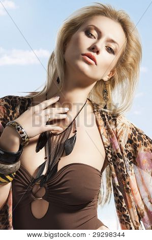 Summer Portrait Of Blond Young Girl, She Looks In To The Lens With Sexy Expression
