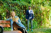 Woman Read Interesting Book Sitting On Park Bench. Interesting Book. Man Walking In Park. Forst Meet poster