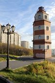 stock photo of murmansk  - Memorial red brick light tower on the hill in Murmansk Russia - JPG