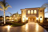 stock photo of dream home  - A huge new luxury home at sunset - JPG