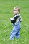 Cute Baby Boy On Grass Background