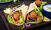 Tortilla Wrap With Falafel And Fresh Salad. Vegan Tacos. Vegetarian Healthy Food. poster