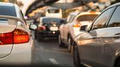 Transportation Vehicle And Traffic Concept - Close Up Car Brake Light On Evening Traffic Jam In Bang poster