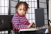 Cute Kid With His Computer poster