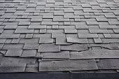 Shingles Roof Damage Covered With Frost. Close Up View On Asphalt Roofing Shingles Background. Roof  poster