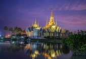 Beautiful Temple Thailand Dramatic Colorful Sky Twilight Sunset Shadow On Water Reflection With Ligh poster