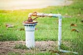 Groundwater Well With Pvc Pipe And System Electric Deep Well Submersible Pump Water On Green Meadow poster