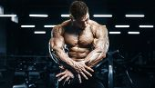Handsome Strong Athletic Men Pumping Up Muscles Workout Bodybuilding Concept Background poster