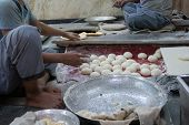 Male Persons Preparing Naan By Hands. Naan Is A Leavened, Oven-baked Flatbread Found In The Cuisines poster