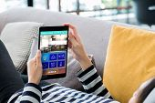 Smart Home Automation Control Concpet.woman Lying Down On Sofa Using Tablet Control Device In Home.d poster