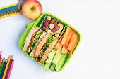 Lunch Box Set Of Ham Cheese Sandwich With Cucumber, Carrot And Nuts, Apple In Box. Kid Bento Packed  poster