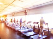 Blurred Background With Fitness Gym People Cardio Workout In Sport Club Center. Blurred Picture Of R poster
