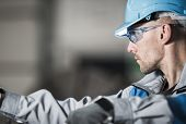Metalwork Industry Worker In Blue Hard Hat And Safety Glasses. Industrial Theme. poster