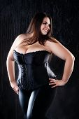Sexy Plus Size Model In Black Corset, Fat Woman With Big Natural Breasts On Dark Background, Body Po poster
