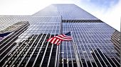 image of usa flag  - Flag of the United States of America in front of the office building - JPG
