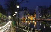 The Houses Near Canal Saint-martin At Night .it Is Long Canal In Paris, Connecting The Canal De Lour poster