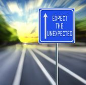 Expect The Unexpected Motivational Phrase On Blue Road Sign With Arrow And Blurred Speedy Background poster