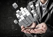 Cropped Image Of Business Woman In Suit Presenting Multiple Cubes In Hands As Symbol Of Innovations. poster