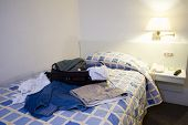 stock photo of guayaquil  - hotel room with open suitcase guayaquil ecuador south america - JPG