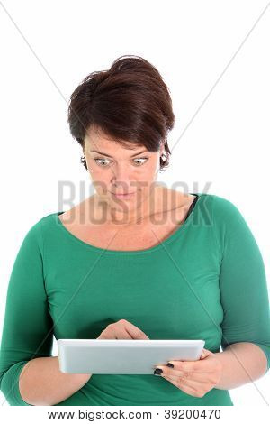 Astonished Woman Reading The Screen Of Her Tablet