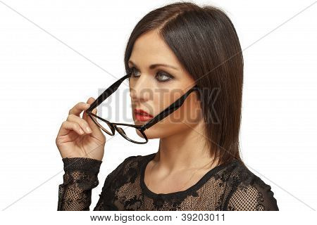Woman taken off glasses from the eyes
