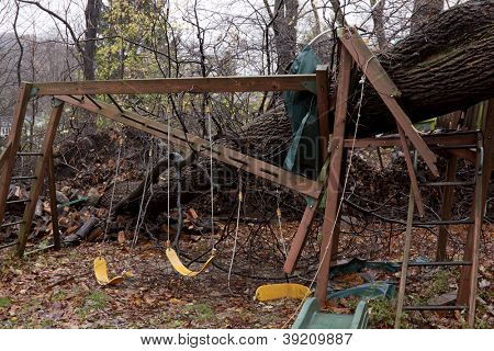 ANDOVER, NJ - OCT 30: A child's playset smashed by a large tree after Hurricane Sandy made landfall in the northeast region of the US in Andover, New Jersey on October 30, 2012.
