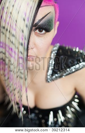 Woman with multicoloured hair and spike dress