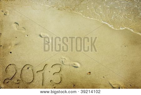 New Year 2013 is coming - numbers written in sand on exotic beach
