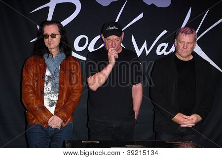 LOS ANGELES - NOV 20:  RUSH - Geddy Lee, Neil Peart, Alex Lifeson at the ceremony where RUSH is Inducted Into Guitar Center's RockWalk at Guitar Center on November 20, 2012 in Los Angeles, CA