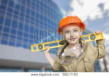 Adorable Child Boy Dressed Up as a Handyman in Front of Corporate Building.