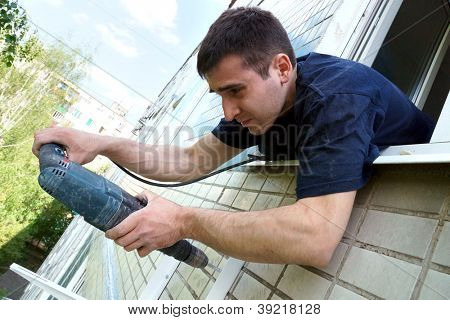 real photo of installation of the conditioner, fastening to a wall
