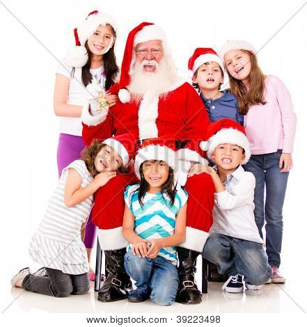 Santa feliz com um grupo de crianças de Natal - isolado sobre o branco