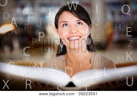 Woman at the library reading books and absorbing the knowledge